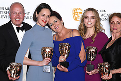 Colin Wratten, Phoebe Waller Bridge, Fiona Shaw, Jodie Comer and Sally Woodward Gentle in the press room during the Virgin Media BAFTA TV awards, held at the Royal Festival Hall in London. Photo credit should read: Doug Peters/EMPICS