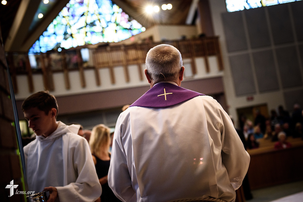 The Rev. Wally Arp, senior pastor of St. Luke's Lutheran Church, prepares for communion at the church on Sunday, March 6, 2016, in Oviedo, Fla. LCMS Communications/Erik M. Lunsford