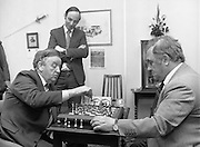 Chess Grand Masters, Clerys,,Dublin 1, Ireland.1982.06.05.1982.05.06.1982.6th May 1982.USSR Chess Grandmaster visits Clerys. Mr Yefim Geller made a personal appearance in Clerys. Clerys sponsored the visit in conjunction with the Irish Chess Union, in agreement with the Russian Chess Federation. ..As Mr Geller plays against Mr Arthur Walls (CEO Clerys) they are watched by Mr Denis Ryan (Co Secretary)