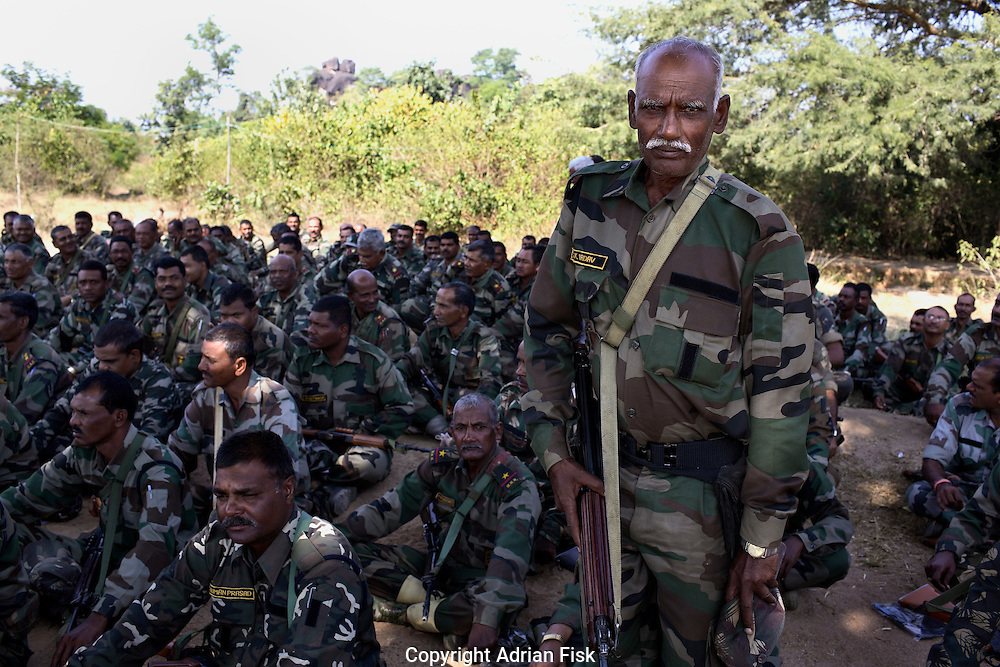 The jungle warfare training college in central Chhattisgarh was specifically set up to train police to combat Naxalism. Policemen aged anywhere between 18 and 60 attend the six week course where they learn everything from catching snakes for food to shooting whilst riding a horse. In its first three years over 6000 policemen have passed the six week course. (pictured) A 60 yr old policeman who has just finished the course stands.