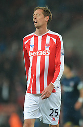 Stoke's Peter Crouch cuts a dejected figure as he walks off the pitch after receiving a red card for a second bookable offence  - Photo mandatory by-line: Dougie Allward/JMP - Mobile: 07966 386802 - 29/10/2014 - SPORT - Football - Stoke - Britannia Stadium - Stoke City v Southampton - Capital One Cup - Fourth Round