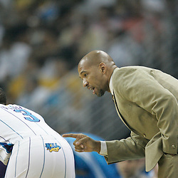 April 24, 2011; New Orleans, LA, USA; New Orleans Hornets head coach Monty Williams talks with point guard Chris Paul (3) during the first quarter in game four of the first round of the 2011 NBA playoffs at the New Orleans Arena.    Mandatory Credit: Derick E. Hingle