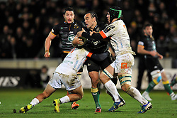 Kahn Fotuali'i of Northampton Saints is double-tackled - Photo mandatory by-line: Patrick Khachfe/JMP - Mobile: 07966 386802 13/12/2014 - SPORT - RUGBY UNION - Northampton - Franklin's Gardens - Northampton Saints v Treviso - European Rugby Champions Cup