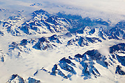 Numerous glaciers flow between mountains on the east coast of Greenland in this aerial view from near Tasiilaq.