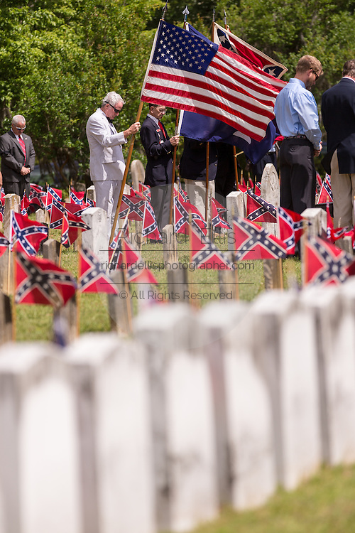 Descendants of Civil War soldiers hold the American and South Carolina flag at a ceremony marking Confederate Memorial Day at Magnolia Cemetery April 10, 2014 in Charleston, SC. Confederate Memorial Day honors the approximately 258,000 Confederate soldiers that died in the American Civil War.