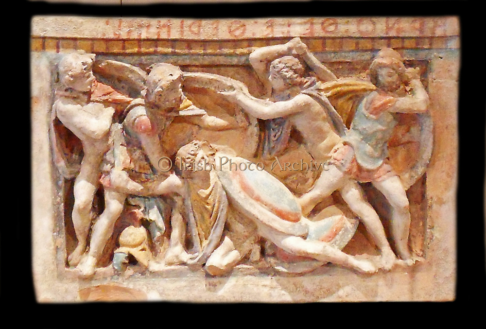 Etruscan cinerary urn depicting a frieze showing a battle scene. 3rd Century BC