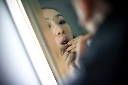 "A participant of ""Miss. International"" beauty contest puts on makeup before the show in Beijing, China, Nov. 7, 2009. Photo by Shiho Fukada"