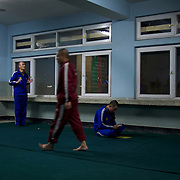 Afghan National Police (ANP) cadet during morning pray in a dorm at the Afghan Nacional Police Academy in Kabul.