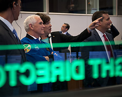June 7, 2017 - Houston, TX, United States of America - U.S. Vice President Mike Pence listens to NASA Deputy Chief Flight Director Holly Ridings, right, and NASA Flight Director Rick Henfling, left, during a tour of the Christopher C. Kraft Jr. Mission Control Center following a ceremony introducing 12 new NASA astronaut candidates at the Johnson Space Center June 7, 2017 in Houston, Texas. Pence celebrated his 58th birthday at the headquarters of the human spaceflight program and spoke of his love for space exploration. (Credit Image: © Bill Ingalls/Planet Pix via ZUMA Wire)
