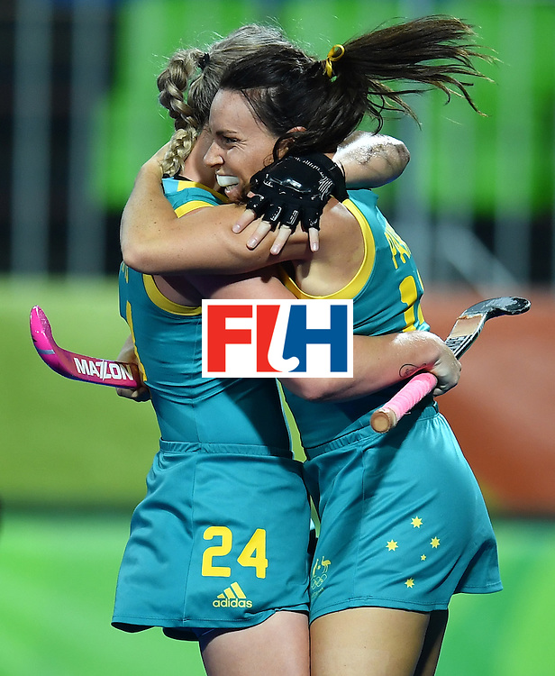 Australia's Mariah Williams (L) celebrates scoring with her team-mate Georgie Parker during the women's field hockey Australia vs Japan match of the Rio 2016 Olympics Games at the Olympic Hockey Centre in Rio de Janeiro on August, 13 2016. / AFP / MANAN VATSYAYANA        (Photo credit should read MANAN VATSYAYANA/AFP/Getty Images)