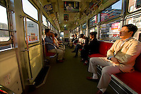 Passengers inside one of Sapporo's tram cars which operate in the heart of the city.