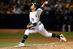 OAKLAND, CA - SEPTEMBER 21: Daniel Mengden #33 of the Oakland Athletics pitches against the Texas Rangers during the ninth inning at the RingCentral Coliseum on September 21, 2019 in Oakland, California. The Oakland Athletics defeated the Texas Rangers 12-3. (Photo by Jason O. Watson/Getty Images) *** Local Caption *** Daniel Mengden