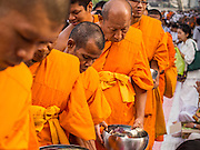 08 SEPTEMBER 2013 - BANGKOK, THAILAND:  Buddhist monks walk through the crowd during a mass alms giving ceremony in Bangkok Sunday. 10,000 Buddhist monks participated in a mass alms giving ceremony on Rajadamri Road in front of Central World shopping mall in Bangkok. The alms giving was to benefit disaster victims in Thailand and assist Buddhist temples in the insurgency wracked southern provinces of Thailand.     PHOTO BY JACK KURTZ