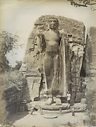 The caption on the back reads The Kalawewa Buddha. it is now known as the Aukana Buddha.<br /> Skeen & Co. Photographs of the historical sites of Ceylon.