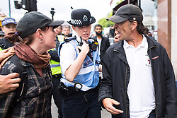 "© Licensed to London News Pictures . 24/06/2017. London, UK. EDL leader IAN CROSSLAND argues with an anti fascist on Whitehall . The English Defence League ( EDL ) hold a March on Parliament , from Charing Cross to Victoria Embankment , opposed by  a counter demonstration by Unite Against Fascism . Scotland Yard said it was using public order laws to restrict the marches ""due to concerns of serious public disorder, and disruption to the community"" following terrorist attacks in Manchester , Westminster and Finsbury Park and the Grenfell Tower fire  . Photo credit: Joel Goodman/LNP"