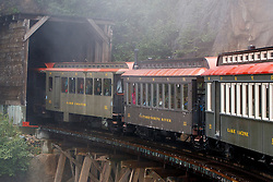 Passenger cars enter a tunnel, White Pass and Yukon Route Railway, Skagway, Alaska, United States of America
