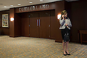 UConn President Susan Herbst takes a call on her cell phone at the Hyatt Regency in Dallas, Texas before watching her school compete in the NCAA Final Four on April 5, 2014. (Cooper Neill / for The New York Times)