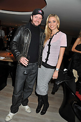 SCOT YOUNG and NOELLE RENO at a party to launch Senkai - London's first modern Japanese-inspired restaurant at 65 Regent Street, London on 26th October 2011.
