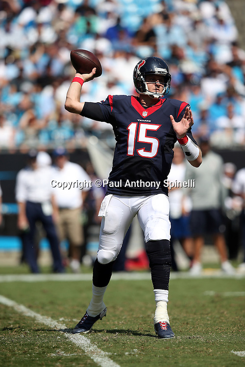 Houston Texans quarterback Ryan Mallett (15) throws a second quarter pass for a completion during the 2015 NFL week 2 regular season football game against the Carolina Panthers on Sunday, Sept. 20, 2015 in Charlotte, N.C. The Panthers won the game 24-17. (©Paul Anthony Spinelli)