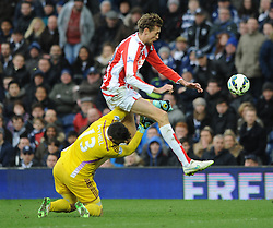 West Bromwich Albion's Boaz Myhill fouls Stoke City's Peter Crouch - Photo mandatory by-line: Dougie Allward/JMP - Mobile: 07966 386802 - 14/03/2015 - SPORT - Football - Birmingham - The Hawthorns - West Bromwich Albion v Stoke City - Barclays Premier League
