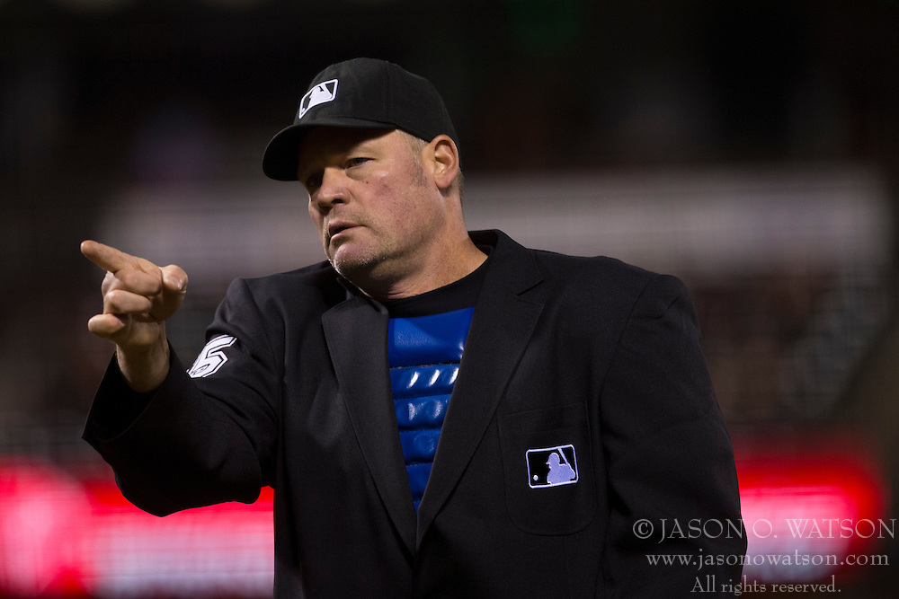 SAN FRANCISCO, CA - MAY 24: MLB umpire Ted Barrett #65 signals to the Colorado Rockies bench during the ninth inning against the San Francisco Giants at AT&T Park on May 24, 2013 in San Francisco, California. The Colorado Rockies defeated the San Francisco Giants 5-0. (Photo by Jason O. Watson/Getty Images) *** Local Caption *** Ted Barrett