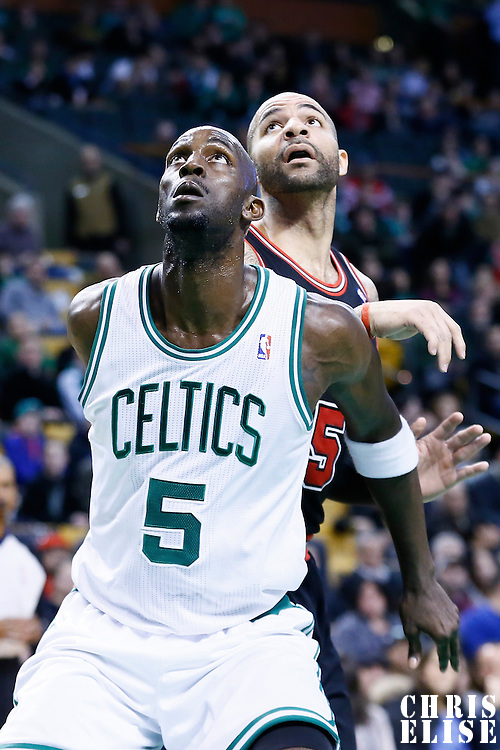 18 January 2013: Boston Celtics power forward Kevin Garnett (5) vies for the rebound with Chicago Bulls power forward Carlos Boozer (5) during the Chicago Bulls 100-99 overtime victory over the Boston Celtics at the TD Garden, Boston, Massachusetts, USA.
