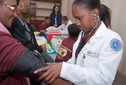 Melissa Lancaaster checks blood pressure of Gertrude Wilson, a member of The Heritage Chorale, Cleveland, OH.216-752-6756