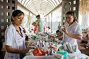 Volunteer Medical students run an emergency clinic from inside the Governor's compound in Tabasco.