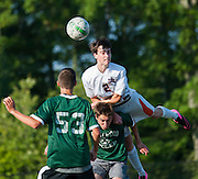 Walpole's Kevin Sullivan dives over Westwood's David Ovalle in an attempt to head the ball in their scrimmage at Westwood High School, September 1, 2015.