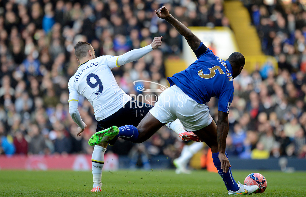 Roberto Soldado challenges Wes Morgan during the The FA Cup match between Tottenham Hotspur and Leicester City at White Hart Lane, London, England on 24 January 2015. Photo by Alan Franklin.