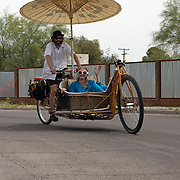 Husband-wife team aboard their parasol-shaded couch bike at first-ever Cyclovia Tucson. Bike-tography by Martha Retallick.