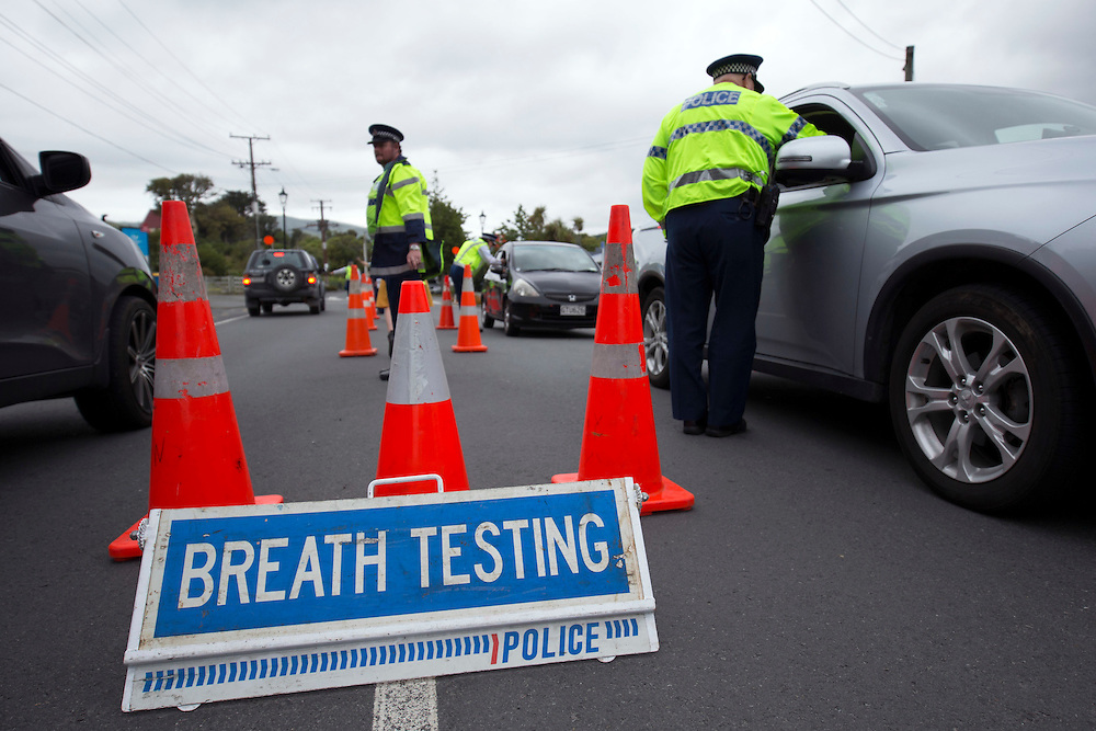 Police officers breath test motorist at a booze bus checkpoint during Operation Safe Families, Mana Parade, Wellington, New Zealand, Friday, December 11, 2015. Credit:SNPA / Martin Hunter