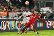 Liverpool midfielder Georginio Wijnaldum (5) battles for possession Bayern Munich midfielder Thiago Alcantara (6)  during the Champions League match between Bayern Munich and Liverpool at the Allianz Arena, Munich, Germany, on 13 March 2019.