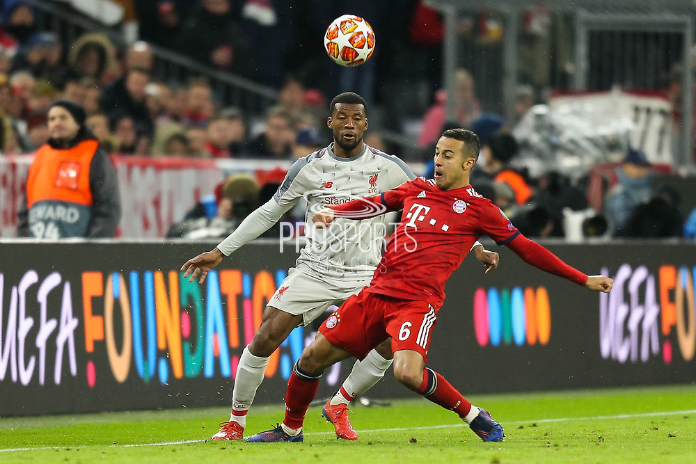 Liverpool midfielder Georginio Wijnaldum (5) battles for possession Bayern Munich midfielder Thiago Alcantara (6)  during the Champions League match between Bayern Munich and Liverpool at the Allianz Arena, Munich, Germany, on 13 March 2019.