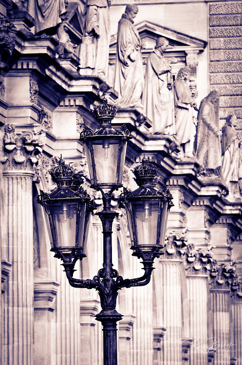 Lamp post and columns at the Louvre Palace, Louvre Museum, Paris, France