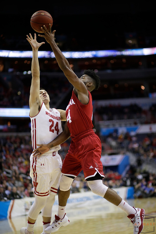 Indiana guard Robert Johnson (4) in action as Indiana played Wisconsin in an NCCA college basketball game in the third round of the Big 10 tournament in Washington, D.C., Friday, March 10, 2017. (AJ Mast)