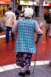 Barcelona, Catalunya,Spain<br /> An older woman walking with her dog in the neighborhood of Poble Sec.&copy; Carmen Secanella