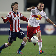 New York Red Bulls player Brandon Barklage (right) is challenged by Jorge Villafana, Chivas USA, during the New York Red Bulls V Chivas USA Major League Soccer match at Red Bull Arena, Harrison, New Jersey, 23rd May 2012. Photo Tim Clayton