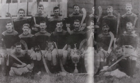 "Kilkenny (Tullaroan)- All-Ireland Hurling Champions 1904. Back Row: Dick Brennan, ""Drug"" Walsh, Eddie Doyle, Paddy ""Icy"" Lanigan, John James Brennan, Martin Lalor, Jack Hoyne. Front Row: Jim Dunne, SIm Walton, Pat Fielding, Dan Stapleton, Ger Doheny (capt), Jim Lalor, Jack Rochfort, Pat ""Fox"" Maher. Foreground: Dick Doyle, Paddy Saunders, J J Brennan and Jim Dunne stood in for Fr Dan Grace and Jack Anthony who had played in final but were not available when the photo was taken."