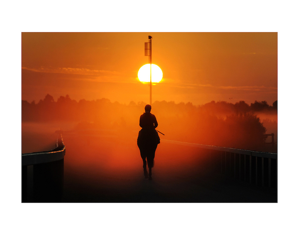 After a strong lead up campaign New Zealand raider Red Ruler was one of the fancies going into the 2008 Caulfield Cup. Here the four year old gelding is given his early trackwork in heavy mist by jockey Corey Brown as they head into a magnificent cup-eve sunrise.<br />