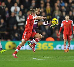 Aston Villa's Karim El Ahmadi wins the ball from Southampton's James Ward-Prowse - Photo mandatory by-line: Alex James/JMP - Tel: Mobile: 07966 386802 04/12/2013 - SPORT - Football - Southampton - St Mary's Stadium - Southampton v Aston Villa - Barclays Premier League