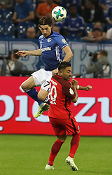 GELSENKIRCHEN, April 19, 2018  Marco Fabian (R) of Eintracht Frankfurt and Benjamin Stambouli of Schalke 04 vie for the ball during the German DFB Pokal match between Schalke 04 and Eintracht Frankfurt at the Veltins Arena in Gelsenkirchen Germany, on April 18, 2018. (Credit Image: © Joachim Bywaletz/Xinhua via ZUMA Wire)