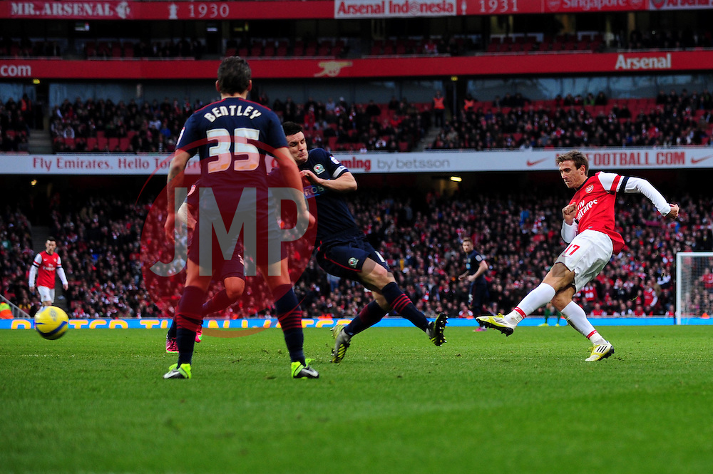 Arsenal's Nacho Monreal shoots from just outside the box - Photo mandatory by-line: Dougie Allward/JMP - Tel: Mobile: 07966 386802 16/02/2013 - SPORT - FOOTBALL - Emirates Stadium - London -  Arsenal V Blackburn Rovers - FA Cup - Fifth Round