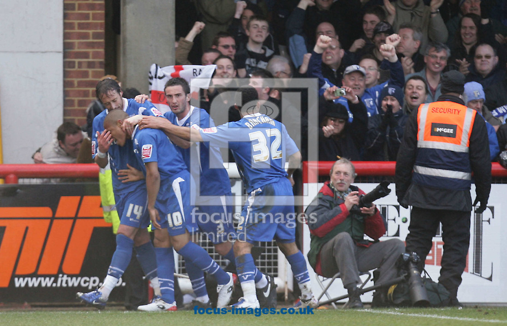 London - Saturday, March 28th, 2009: Simeon Jackson (2nd L) of Gillingham celebrates his side's first goal with team mates Adam Miller  (L), John Nutter  and Andy Barcham during the Coca Cola League Two match at Griffin Park, London. (Pic by Mark Chapman/Focus Images)