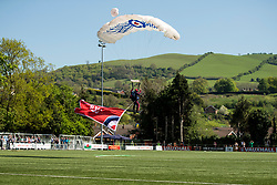 NEWTOWN, WALES - Sunday, May 6, 2018:  A member of the RAF Falcons display parachuting team lands on the pitch before the FAW Welsh Cup Final between Aberystwyth Town and Connahs Quay Nomads at Latham Park. (Pic by Paul Greenwood/Propaganda)