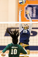 November 7, 2014. Costa Mesa, CA. Danyelle Brown (15) blocks the lobby by Gabi Nguyen (10) in the conference match up between Orange Coast and Golden West in the conference match up held at Orange Coast College. Image Credit Amanda Schwarzer