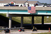 Members of the American Legion ride down James River Freeway during the American Legion Legacy Ride on Monday, August 19, 2013. The American Legion Legacy Ride raises funds for children of active duty military members who are killed in the line of duty to go to college. (David Welker/For the News-Leader)