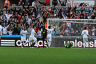 Swansea city's Pablo Hernandez (2nd left) celebrates after he scores the opening goal. Barclays Premier league, Swansea city v Wigan Athletic at the Liberty Stadium in Swansea, South Wales on Saturday 20th October 2012. pic by Andrew Orchard, Andrew Orchard sports photography,