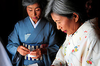 Kozuo Knowles and Yoshie Okazaki place sweets on individual plates to serve at the tea ceremony during the 2012 Obon Festival at the Buddhist Temple of Salinas.