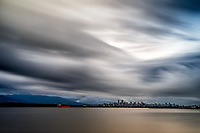 Grey Dawn: Dawn from Jericho Beach and a very long exposure captures downtown under a most dynamic grey blue sky, Vancouver British Columbia Canada.